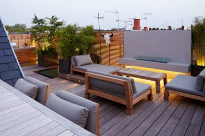 A roof terrace with an outdoor fireplace