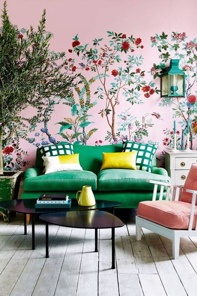 Pink wallpaper with green sofa