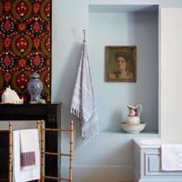 Blue Bathroom with Antique Textiles