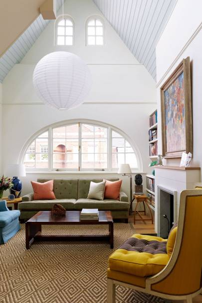 White living room with gabled ceiling
