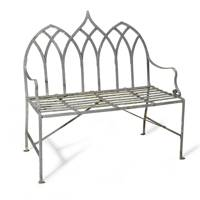 A PAIR OF REGENCY GOTHIC REVIVAL WROUGHT IRON GARDEN SEATS