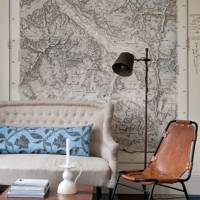 Map wall covering and blue carpet