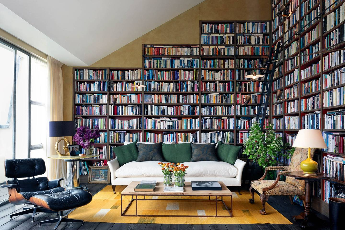 ceiling high book cases in living room