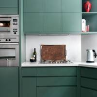 Green Kitchen with Zigzag Flooring