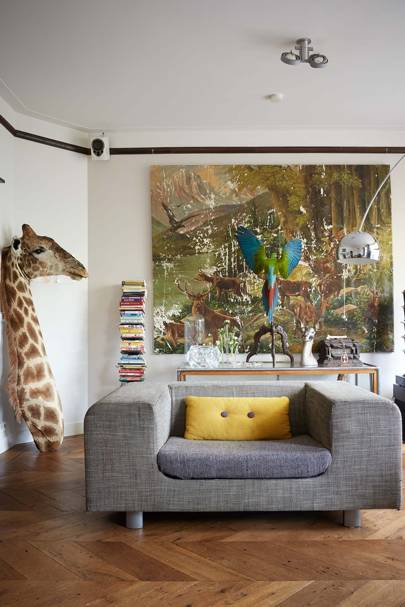 Modern living room with grey sofa and taxidermy