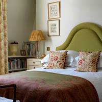 Small Grey Bedroom With Green Headboard