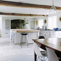 White Kitchen Units & Limestone Floor