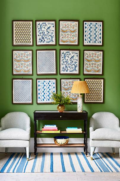 Green Living Room with White Arm Chairs and Gallery Wall
