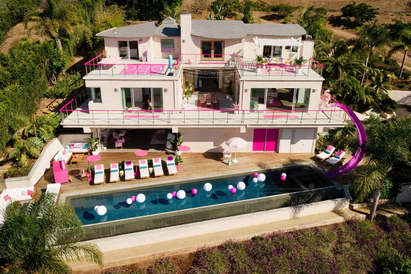Airbnb and Mattel have brought the Barbie Dreamhouse to life, and it is very pink