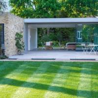 Modern Glass Garden Room with Patio