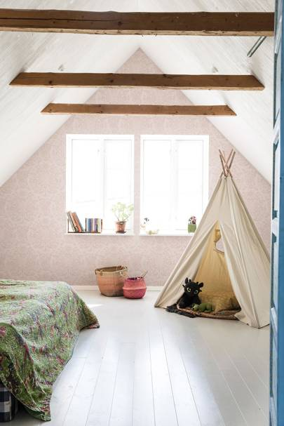 Attic bedroom with wallpapered apex