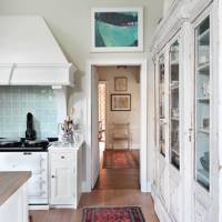 White Kitchen with Wooden Floorboards