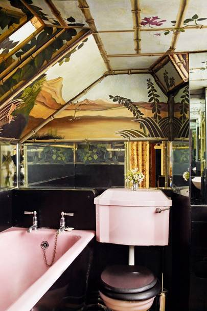 Rousseau-inspired bathroom with pink bath