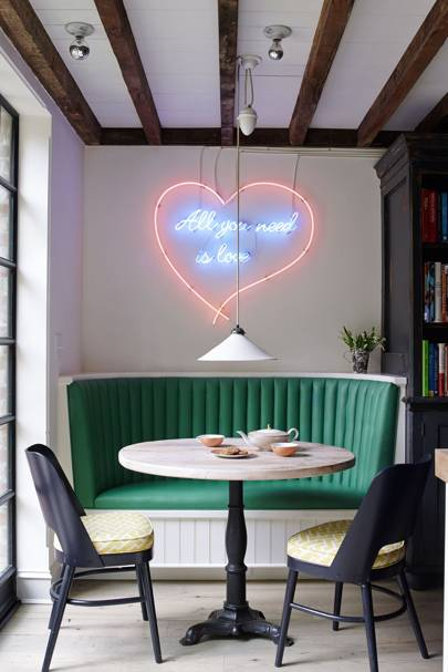 Small Round Dining Table with Curved Green Banquette
