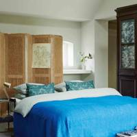 Farmhouse Bedroom with Blue Bedspread