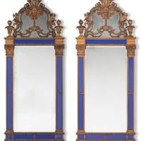 Lot 201: A Pair of North European Stained Beech and Pine and Blue-Glass Mirrors, possibly Swedish, late 19th century (estimate £4,000-£6,000)