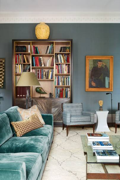 Soft blue living room with asymmetric bookcase