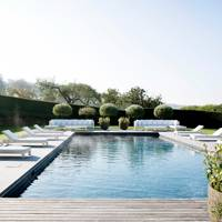 Swimming Pool with White Furniture