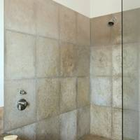 Shower room with neutral tiles