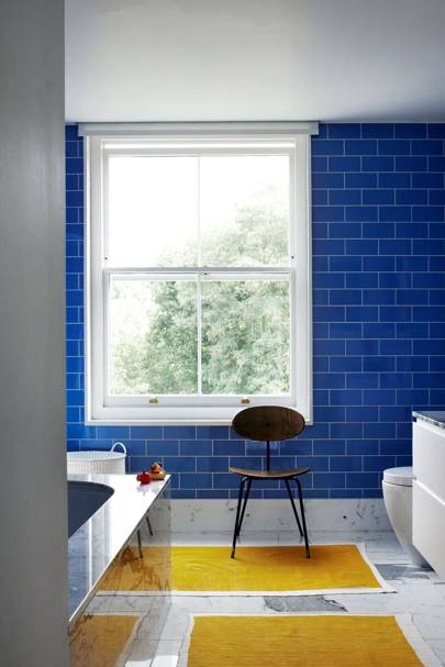 Blue tiles with yellow bathmats