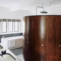 Bathroom with walnut shower pod