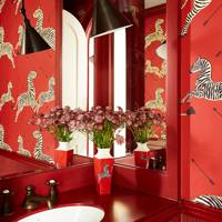 Red vibrant wallpaper bathroom