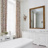 White Bathroom With Floral Curtains