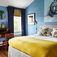 Small Bedroom Blue Walls Yellow Bedspread