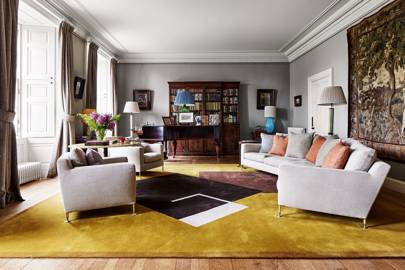 Modern country house living room with yellow carpet
