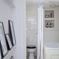 Bathroom with geometric floor tiles and white metro wall tiles