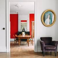 Dining area with statement red wall