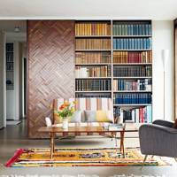 Living room with reclaimed parquet panelling and built-in bookshelf