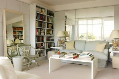 Small White Living Room With Mirror Wall