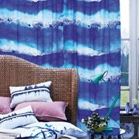 Blue Curtain & Wicker Bed