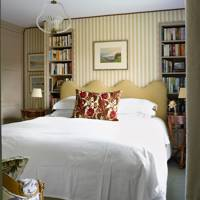 Small bedroom With Built-in Alcove Bookcases
