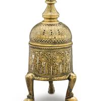 AN AYYUBID SILVER-INLAID BRASS DOMED CYLINDRICAL INCENSE BURNER