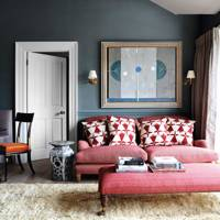 Blue walls with red sofa and ottoman