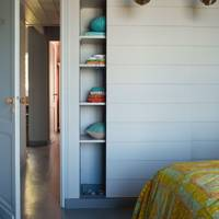 Bedroom with concealed wardrobe