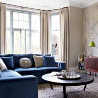 Living Room with Velvet L-Shaped Sofa and Map Print Wallpaper