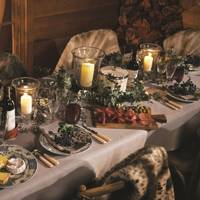 A festive feast with candles and greenery