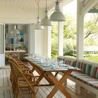 Veranda with Long Table and Pendant Lights