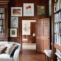 Framed Artwork in Dark Wood Panelled Hallway