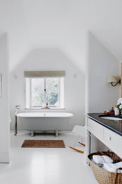 White Bathroom with Floor Standing Taps