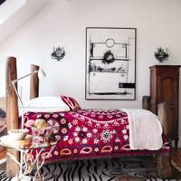Bedroom decorating idea featuring reclaimed wood