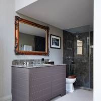 Grey bathroom with marble shower enclosure