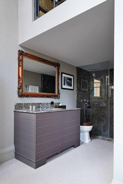 Grey bathroom with antique mirror
