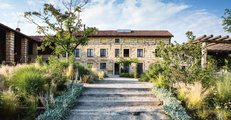 A low-maintenance garden at an Italian hillside villa