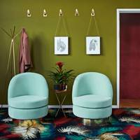 Olive green hallway with twin armchairs