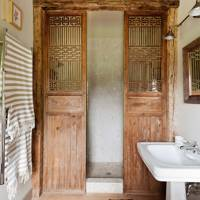 Salvaged Wood Doors as a Shower Screen