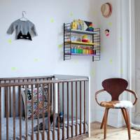 Modern nursery with polka dot wallpaper